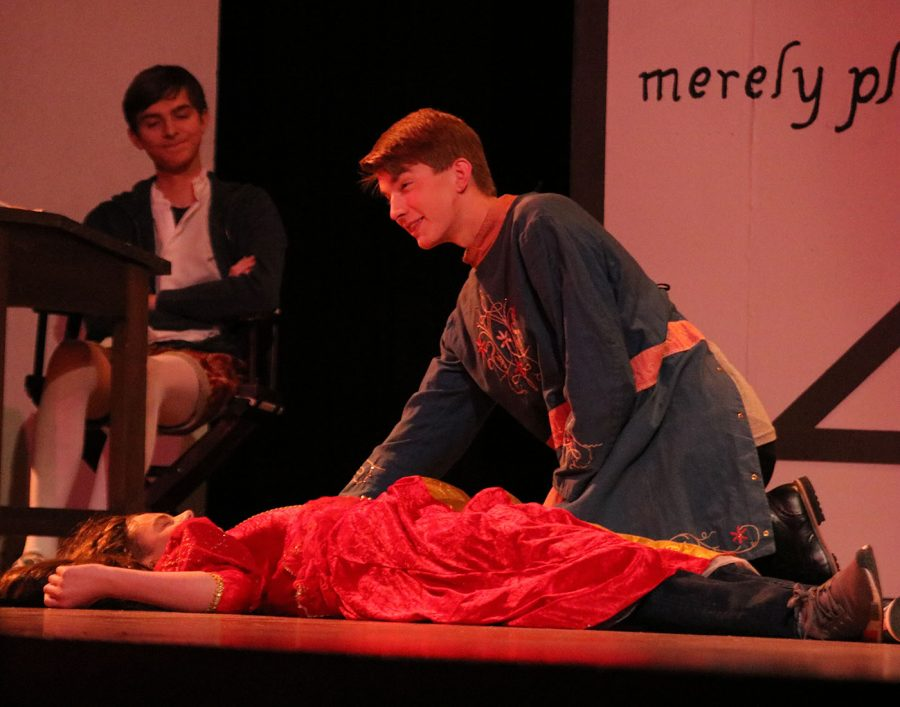 Evan Peterson as Romeo mourns his dead love, Juliet, played by, Jackson Hemann