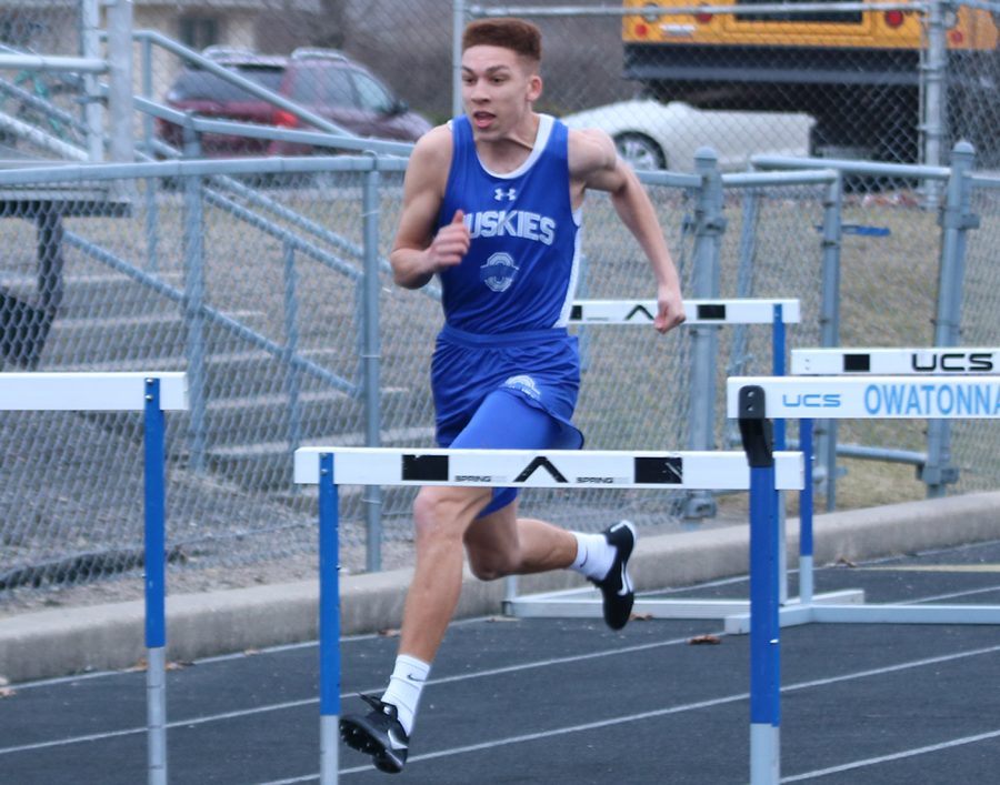 Junior Keenan Young running 110 meter hurdles