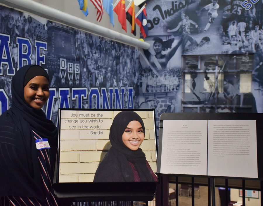 Sado Keyse stands next to her photo and written story for OHS to see