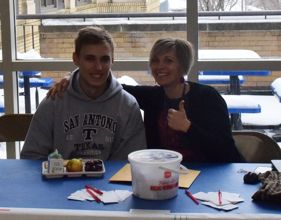 Lincoln Maher and Mrs. Fink run the BBBS raffle booth