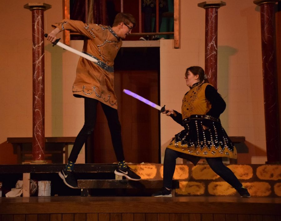 Evan Peterson as Laertes and Kenna DaMitz as Hamlet fight to the death