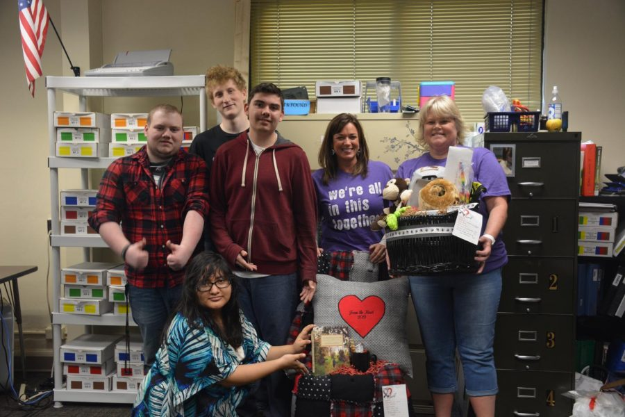 From+the+Heart+organizers+and+OHS+students+posing+with+a+donated+silent+auction+basket+they+created