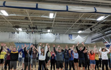 OHS Concert Choir practices their choreography for the Pop Concert in the gymnasium.