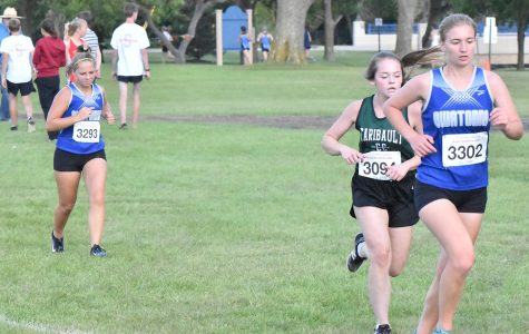 Sophomore Betsy Wunderlich and Senior Chloe Schmidt running during the Faribault race