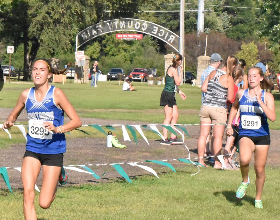 Sophomores Laura Stevensen and Hannah Potter running at the Faribault race