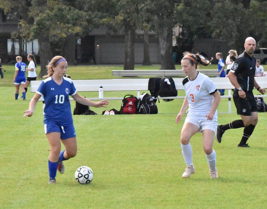 Senior Gabriela Breuer looks to dribble pass a defender