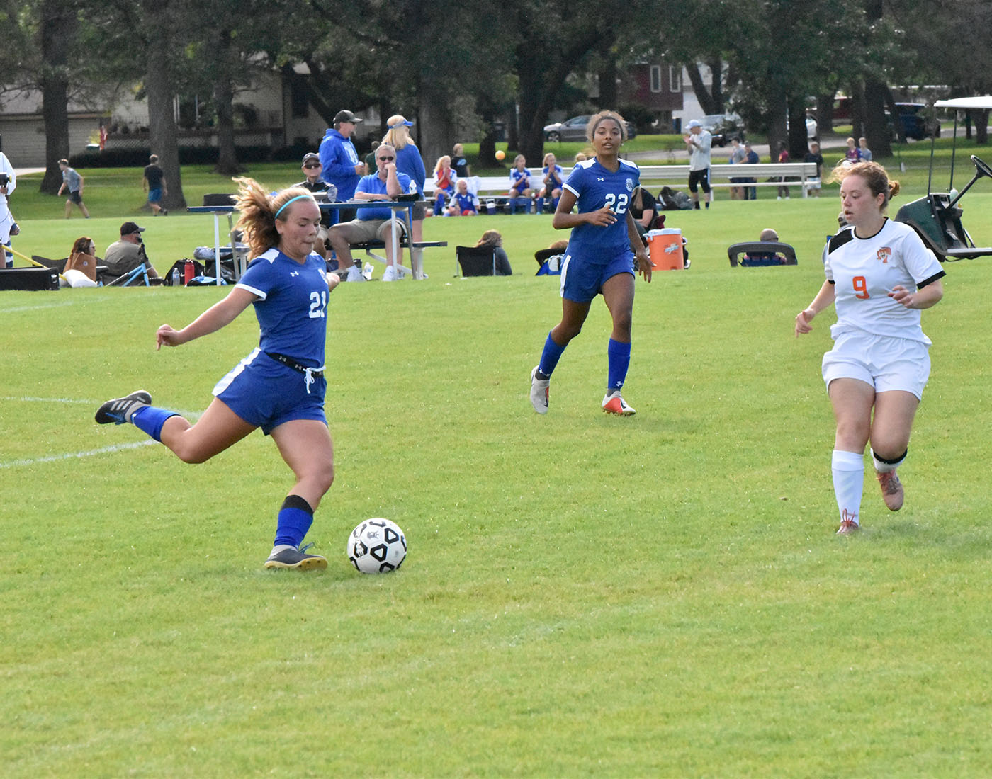 Senior Karingtan Stanford passes the ball down the pitch