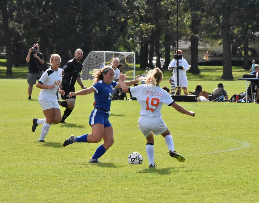 Senior Karingtan Stanford keeps the ball away from a defender