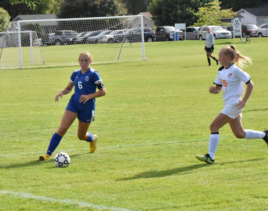 Senior Kaia Elstad dribbles the ball away from a defender