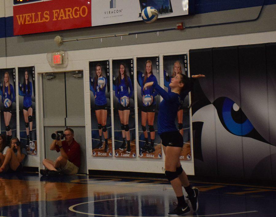 Junior Emily Hagen serves the ball