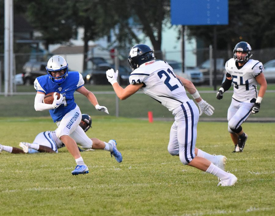 Senior Ethan Walter rushes down the field