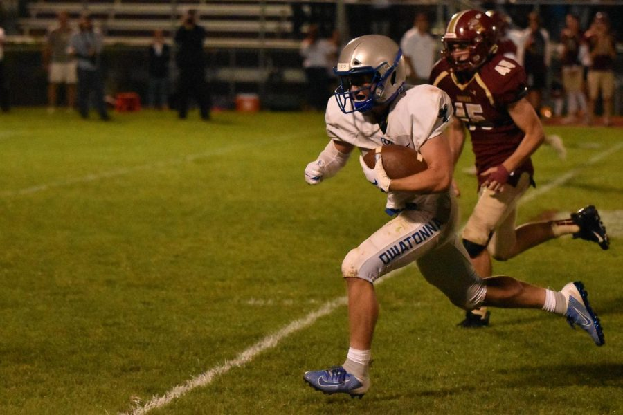 Senior Ethan Walter rushes for the end zone
