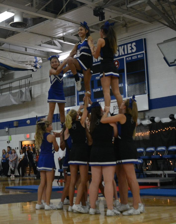 Owatonna cheer time flying in the air