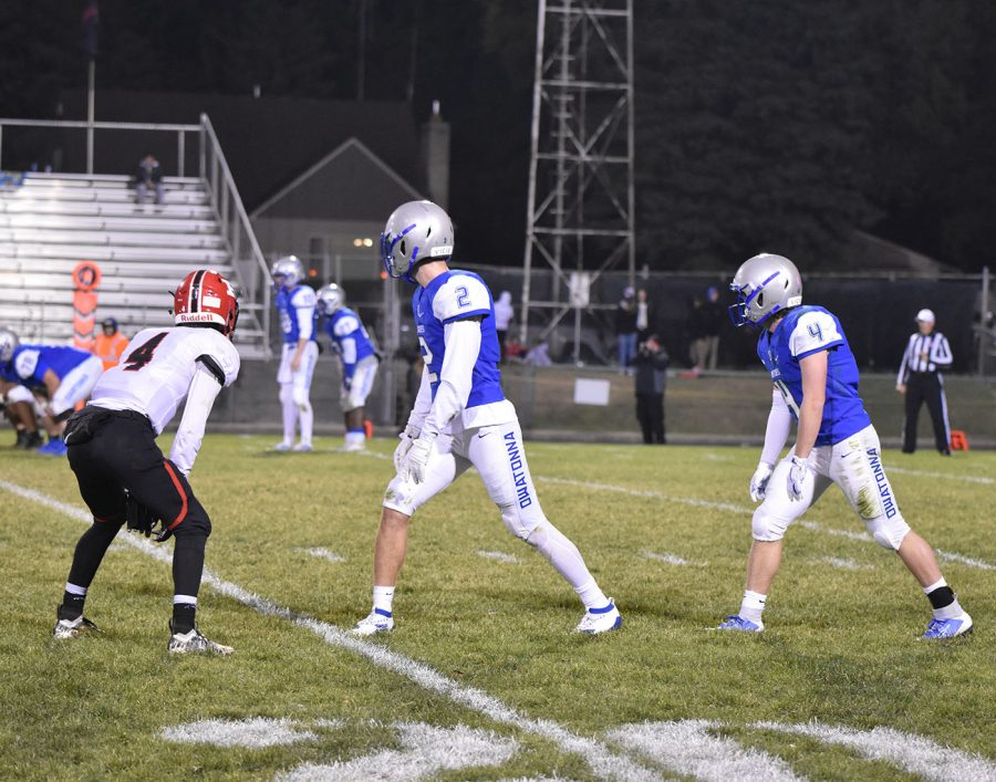 Seniors Isaac Oppegard and Ethan Walter get set for the snap