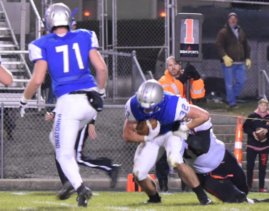 Senior Hunter Menden gets a pick against Rochester John Marshall
