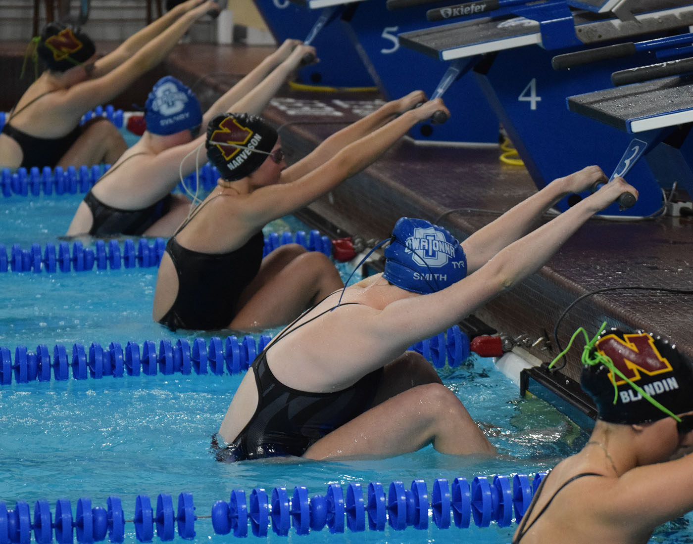 Husky swimmers taking their marks before the 100 backstroke
