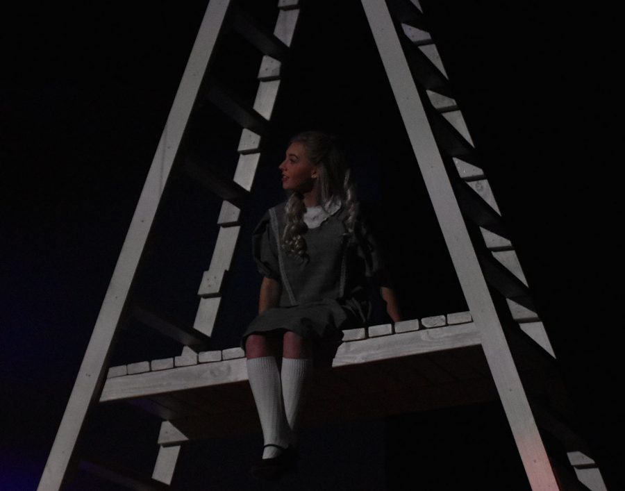 Whitni Minton sits upstairs and admires the moon