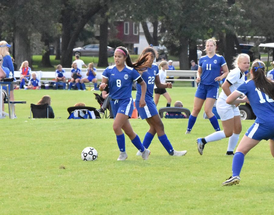 Senior center midfielder Asia Buryska drives down field against opposing team