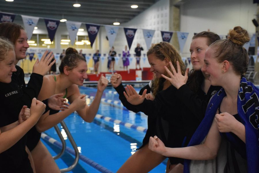 Owatonna%27s+Emily+Larson+and+her+cousin+Faribault%27s+Abby+Larson+squaring+up+before+a+meet
