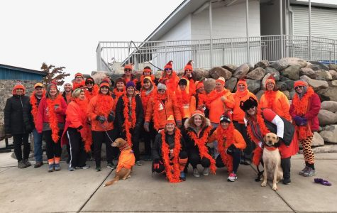 Margo's Hot Mess Express all wearing orange to represent their team at the Jingle Bell Run