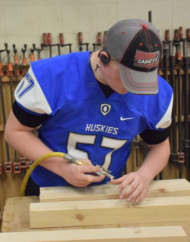 Junior Bailey Keck working on his project