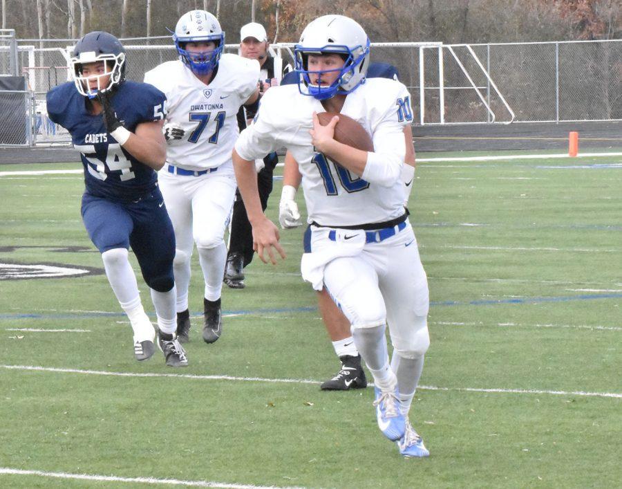 Junior Brayden Truelson makes a break along the sideline