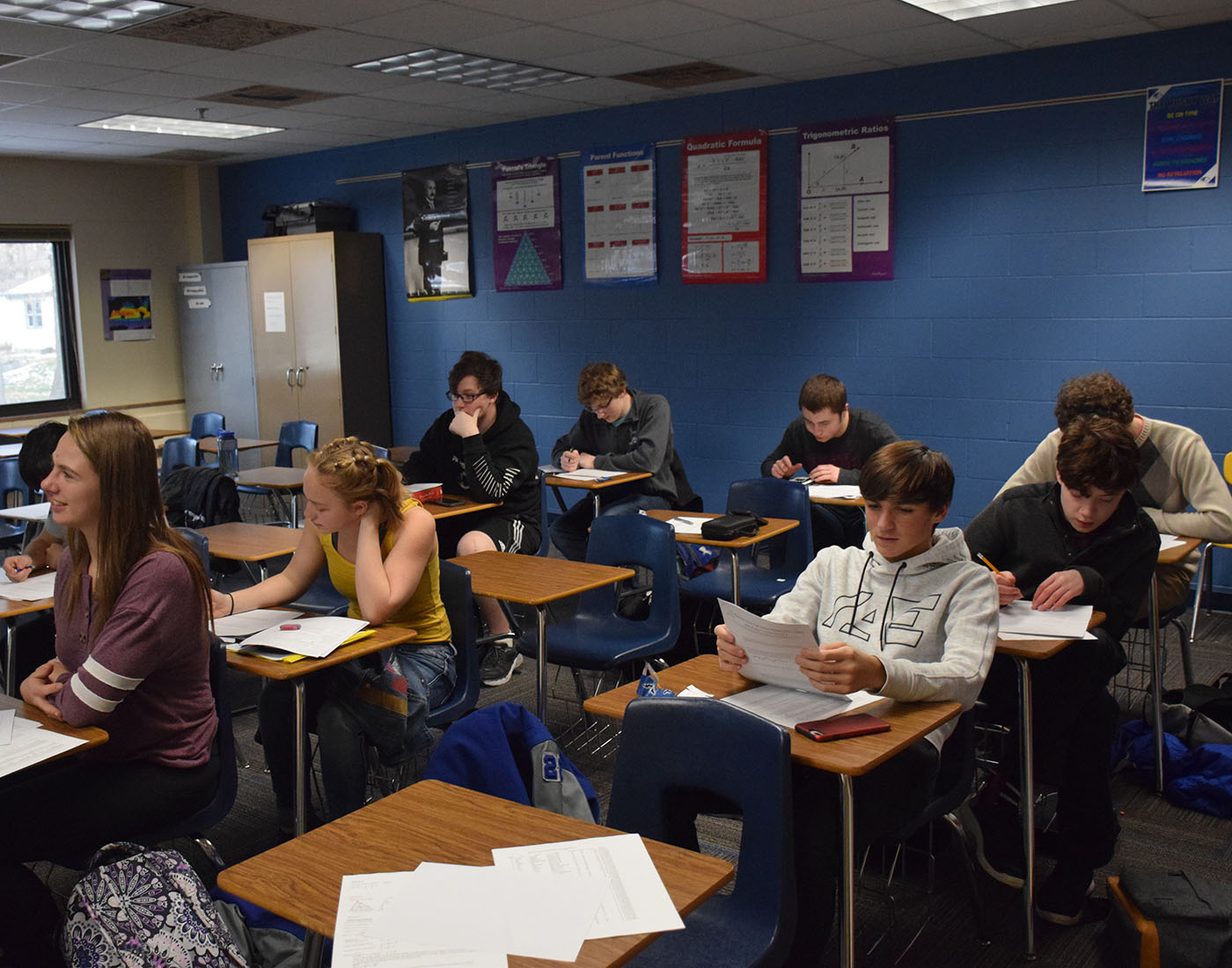 The math league team practicing in Mr. Benson's room before the next meet
