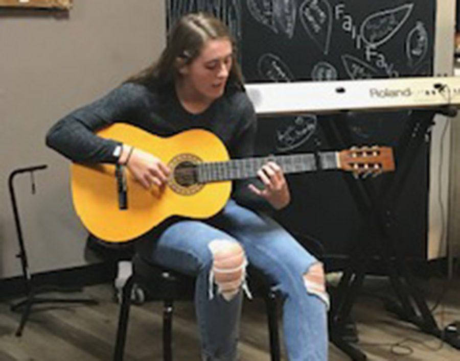 Senior Kaia Elstad performs with her guitar