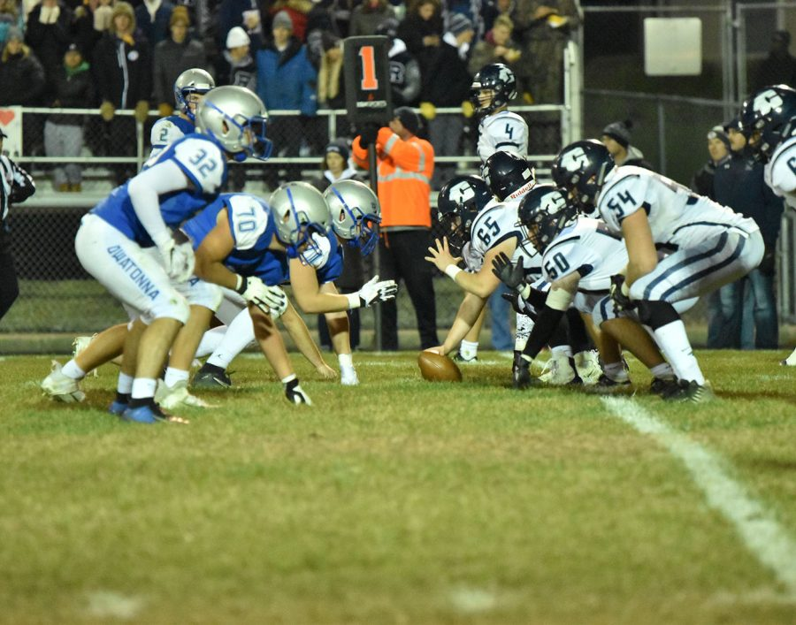 Owatonna defense on the line of scrimmage