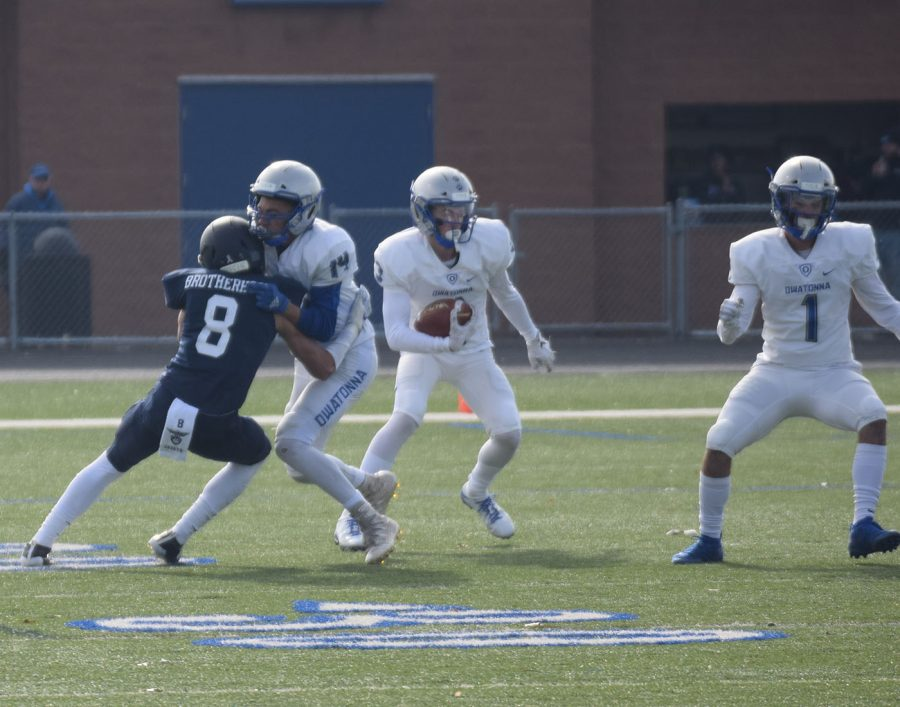 Senior Keenan Young blocks for junior Peyton Beyer's punt return