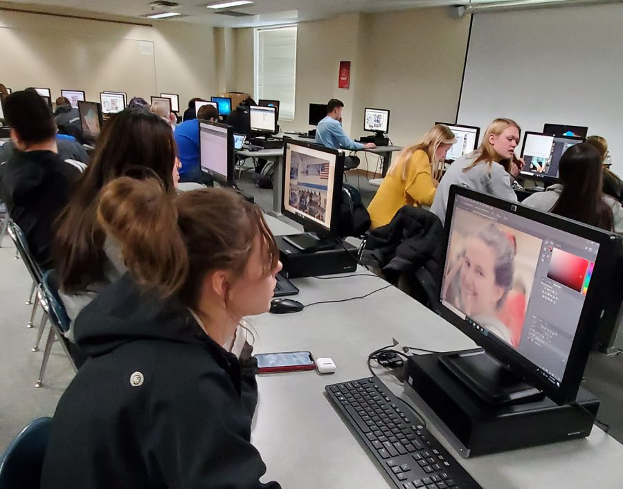 students-working-in-yearbook