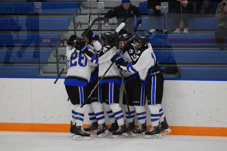 The Owatonna Boys Hockey team celebrates  a goal against Rochester John Marshall