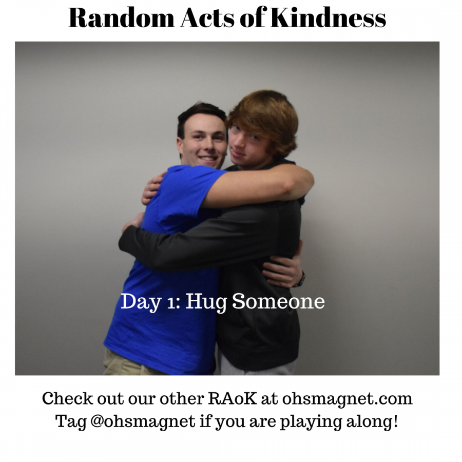 Day 1: Hug Someone Magnet reporters Zach Wiese and Isaac Goettl showcase the Kindness Calendar