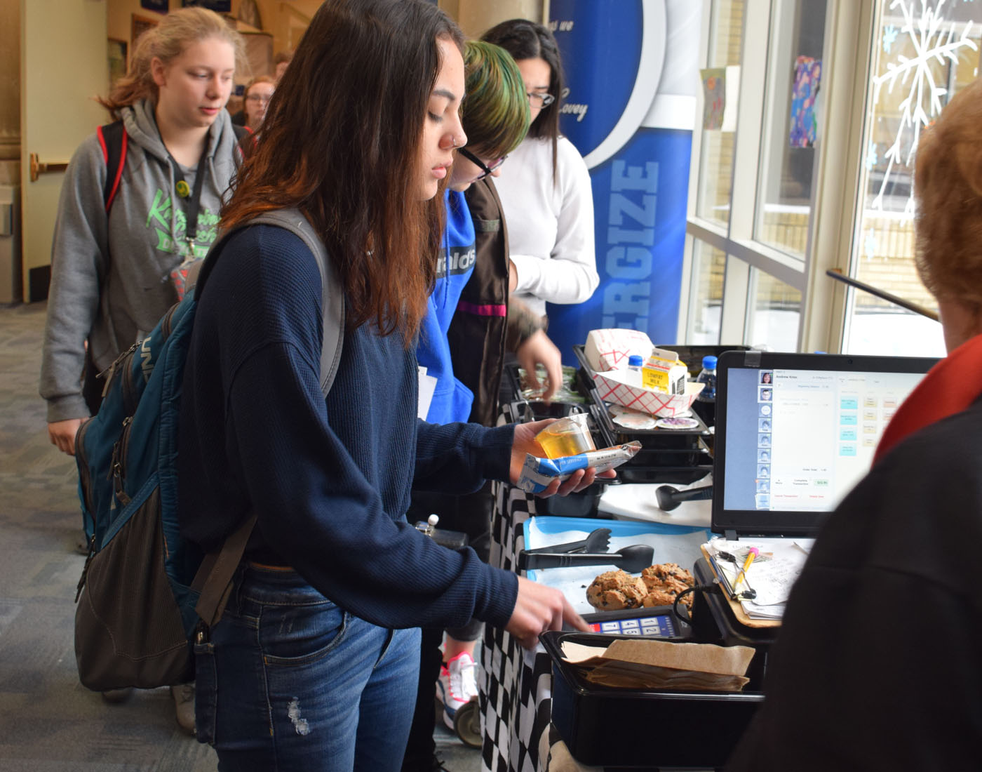 Student getting breakfast at the 2nd chance breakfast line