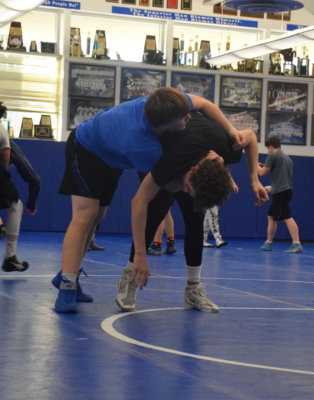 Junior Matt Seykora and Junior Landon Johnson at wrestling practice.
