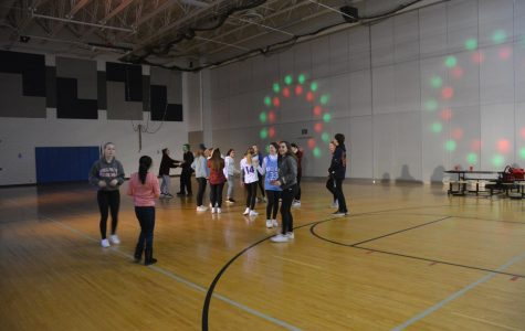 Students get groovy at the dance.