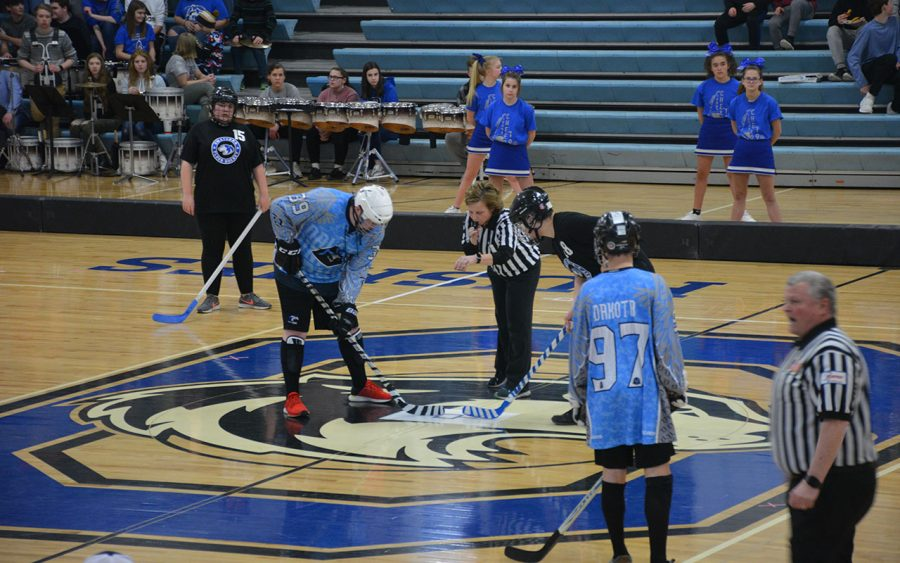 The first face off of the Adaptive Floor Hockey Game
