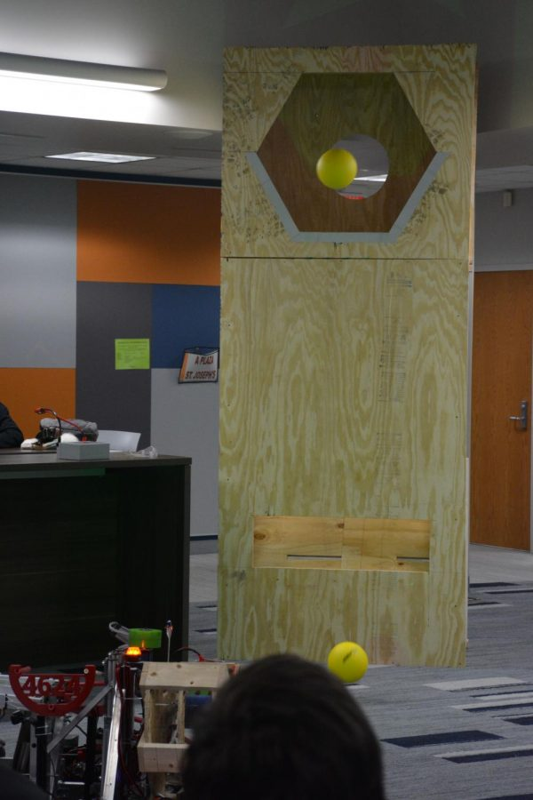 Demonstration of robot throwing balls into holes for points