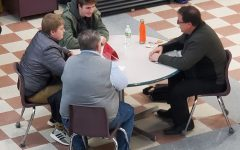 Students talking to Mr. Guenther at conferences on Monday, Feb. 17.