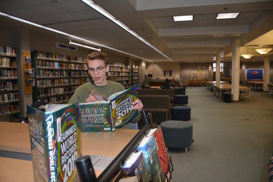 Student Nolan Ideker reading