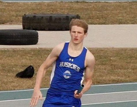 Nick Steele running his leg in a relay