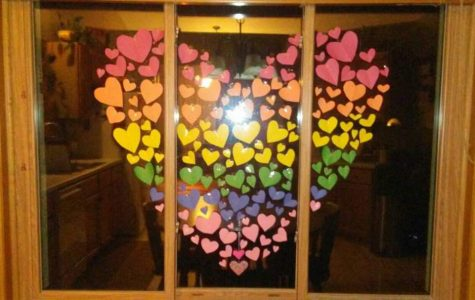 A heart made of hearts on a window