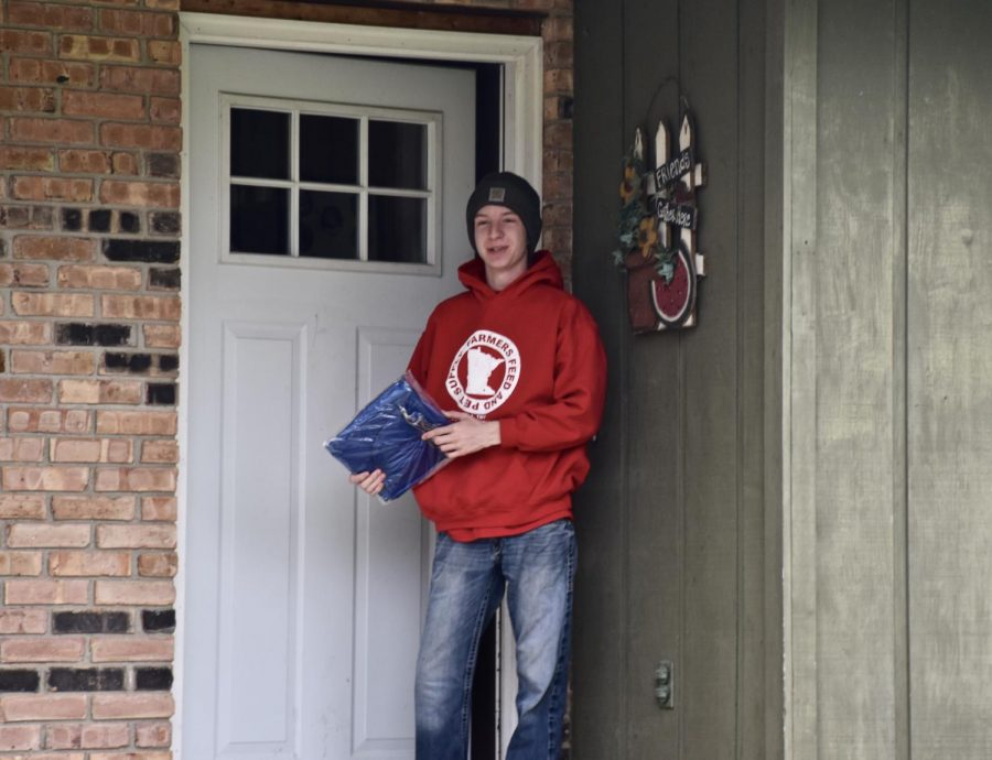 Senior Hunter Dallman surprised to see OHS staff dropping off his cap, gown and yard sign