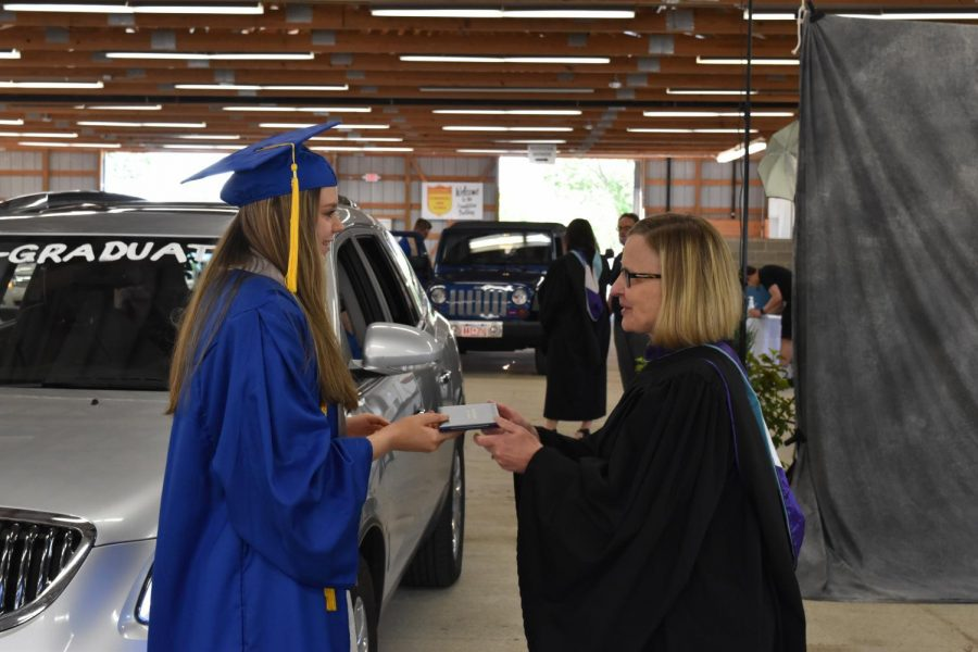 Emily Maine receiving her diploma from Mrs. Stephani.