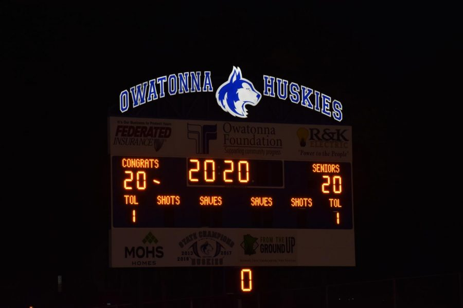 Football field scoreboard lit up for the graduates.