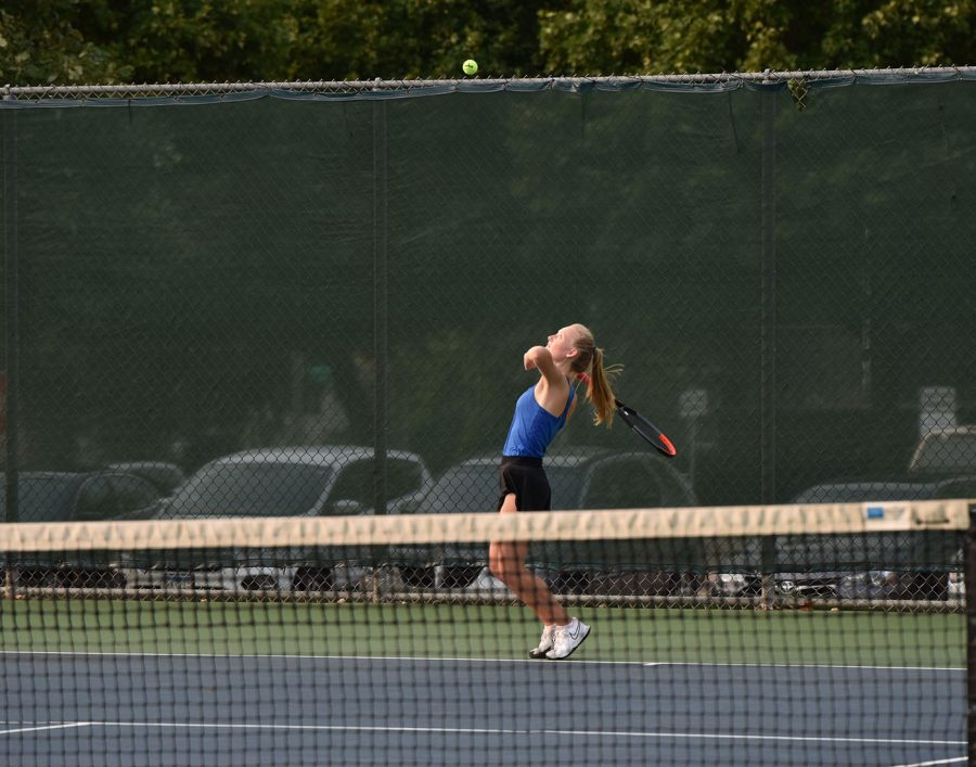 Alex Huemoeller prepares to hit a serve to her Albert Lea opponent