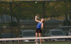 Caitlynne Bussert serving to her Alber Lea opponent