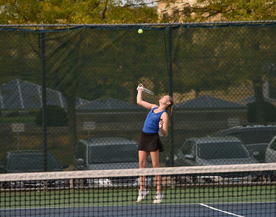 Caitlynne+Bussert+serving+to+her+Alber+Lea+opponent