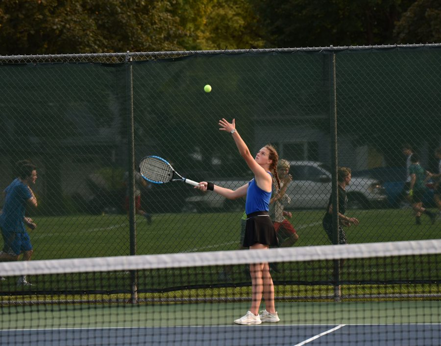Klara Blacker throws up the ball to serve it to her opponent