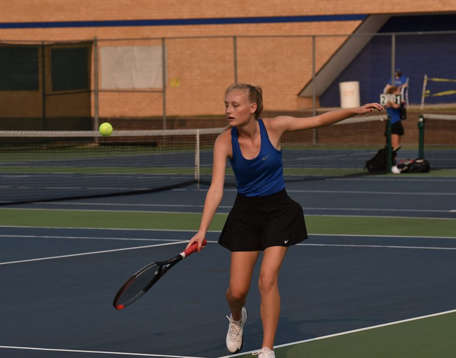 Alex Huemoeller returns a backhanded shot to her Albert Lea opponent